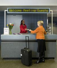Welcome center attendee greets guest