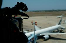 Video camera observing airplane