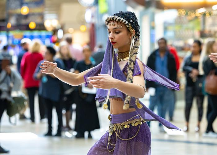young woman performs at terminal 1 during nutcracker ballet performance